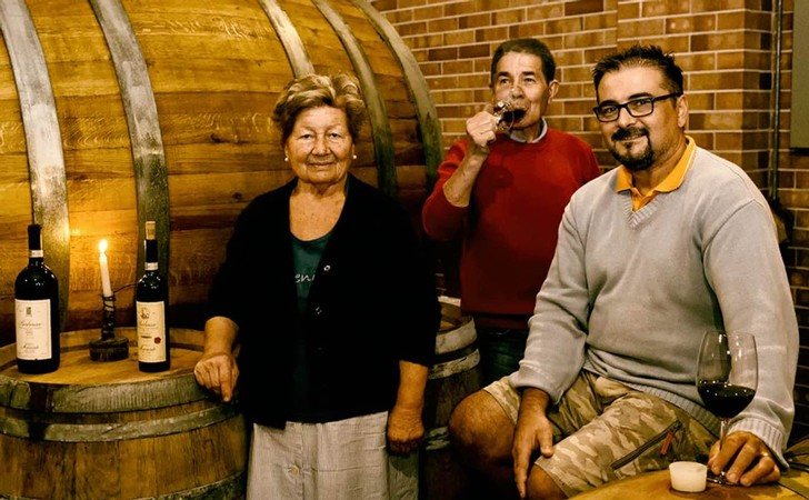 The Mainerdo family in the wine cellar at Mainerdo Wines in Italy